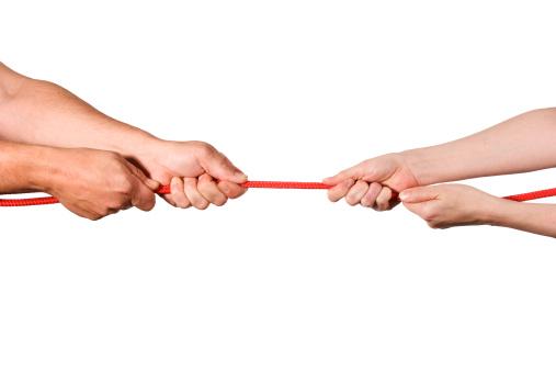 Hands playing tug o' war